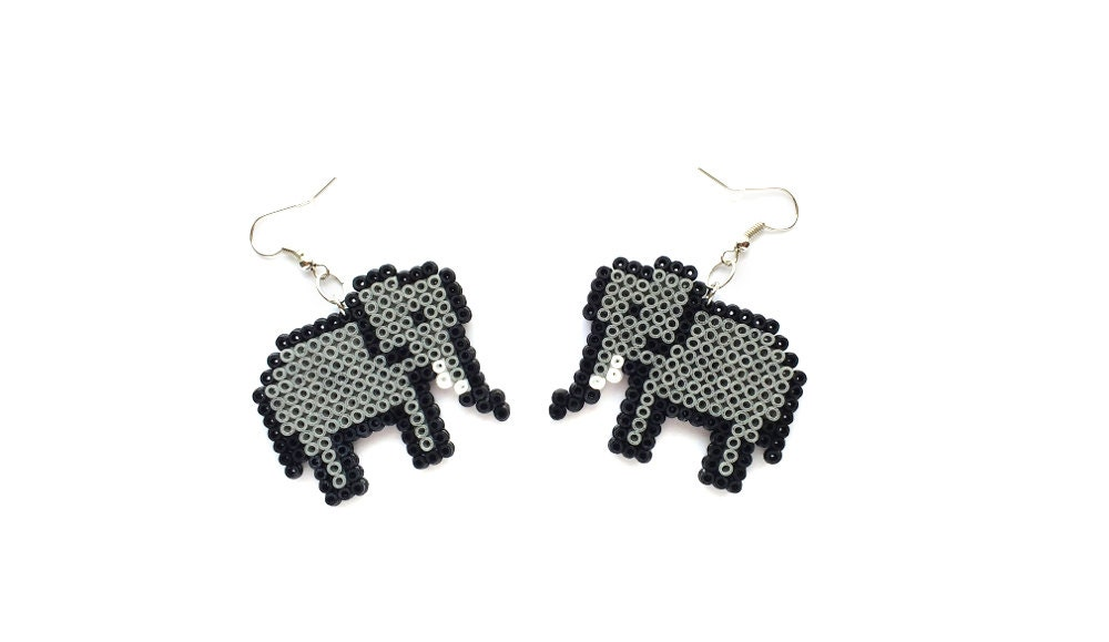 addiction s eve elephant silver earrings sterling dangle