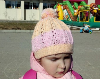 Spring/Fall hand knitted hat for a child with a pompom