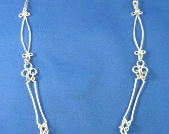My Signature Silver Chain -- Each link is a different design.