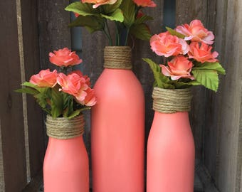 Coral bottles, set of three, with twine and coral flowers