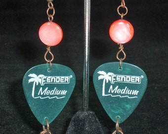 Earrings, dangle, aqua green guitar pick with orange bead and aqua green Swarovski crystal