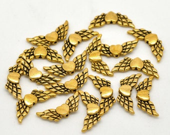 Winged hearts (x 6) gold metal beads