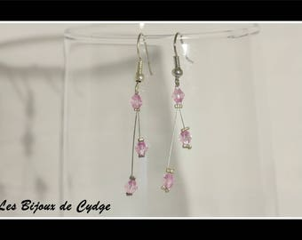 Earrings on twisted wire and its purple pink bicone bead