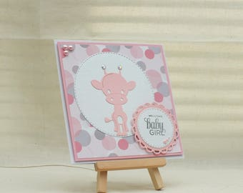 Handmade welcome baby girl card with giraffe and circles in pink/white and grey