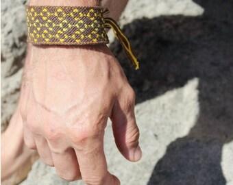 handmade custom woven friendship bracelet. men.women.boys. holiday. festival. fall fashion. parties. cotton knotted threads.button. pattern.