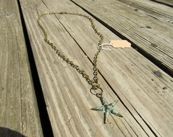 Turquoise and bronze-colored star pendant necklace