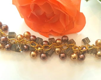 Beaded bracelet in brown shades and gold