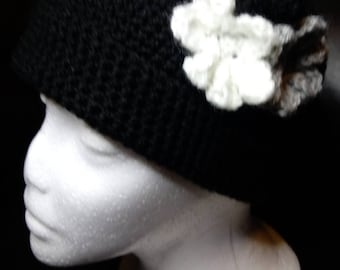 Floral black crocheted beanie.