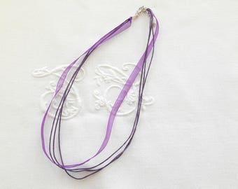 A pendant necklace in purple Organza cord.