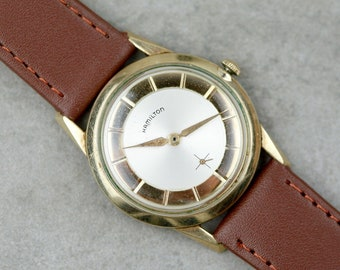 Vintage Hamilton mens 'Arnold' watch gold case with mechanical wind up watch with original magazine ad