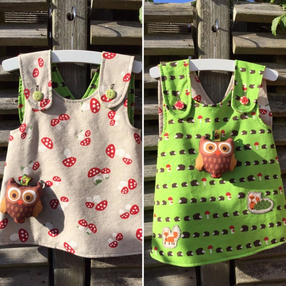 Sale! -20% Double sided baby girl pinafore hedgehogs, two foxes and mushrooms with a toy rattle owl attatched size 74 or 6-9 months