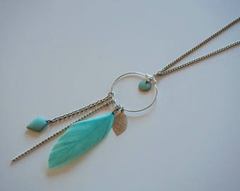 Necklace with hoop attached to a pastel green feather, chains and enameled beads