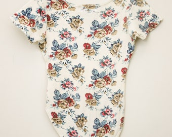 Short Sleeve Floral One piece Shirt with Snaps at Crotch.