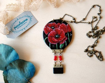Wooden necklace with hot air balloon. Flowered Meadow with red poppies