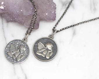 Cherub necklace etsy 925 sterling silver cupid angel pendant necklaceangel charm necklacesterling silver angel necklace aloadofball Image collections