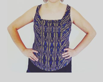 Sleeveless green blouse made out of Guatemalan fabric.