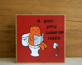 """ART BLOCK: """"A Good Poop Makes Me Happy"""" featuring a cat on a toilet reading the newspaper"""