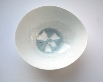 Porcelain bowl. Decorative stoneware fine bone china bowl with a unique texture and glossy interior