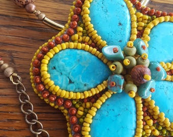Bead embroidered pendant. Gaudi V. Floral jewelry. Glass beads. Dyed howlite, wood.
