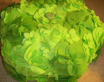 Pouf covered with lime green felt flowers  and beaded center measures 18 X 11