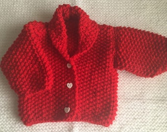 Hand knitted red baby cardigan ( ONLY 1 AVAILABLE ) Gift wrapping available.