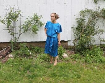 1980s midi length blue dress, cap sleeve, drop waist, metallic rose floral, wrap skirt, elastic waist, medium, synthetic