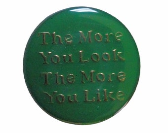 ThE MoRE YoU LOOK THe MoRE YoU LiKE vintage lapel  enamel pin slogan