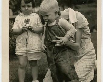 Hidden mom cute little kids holding flower fashion 1934 vintage found snapshot photo