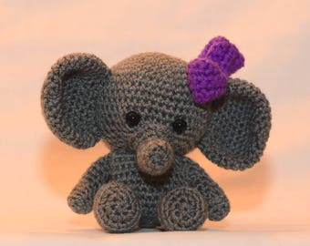 A cute little elephant. Tiny Zoo Ellie the Elephant. Hand crocheted little elephant, a plush softie animal.