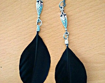 Earrings with natural duck feathers