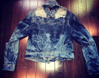 Authentic custom ripped acid washed denim jacket.