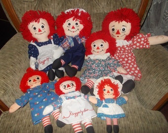 Six Raggedy Ann's and an Andy puppet