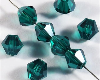 Set of 30 6mm - emerald green Crystal bicone beads
