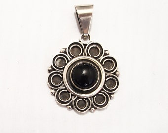Silver flower pendant and Onyx stone