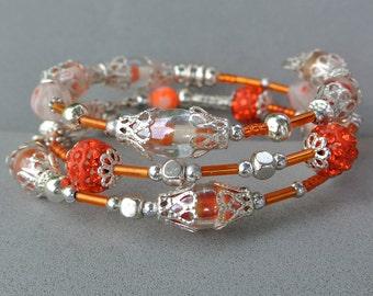 Memory Wire Bracelet in Orange and Silver. Handmade in UK