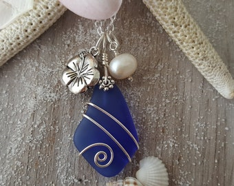 Handmade in Hawaii, Wire wrapped cobalt sea glass necklace,  Fresh water pearl, Hibiscus charm, Sterling silver chain, Gift for her.