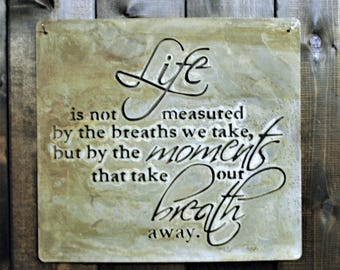 "Life is not Measured, is a metal laser cut sign with a natural finish. It measures 16"" x 15"""