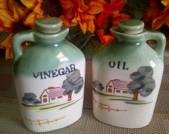 Oil And Vinegar Salad Cruets. 1950's To 1960's. Rural Scene Of Farm House, Trees And Fence.