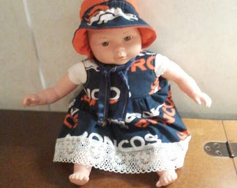 13 inch doll with dress, panties and bonnet with the Denver Broncos on them