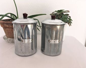 Vintage set of stainless steel mid century spice jars