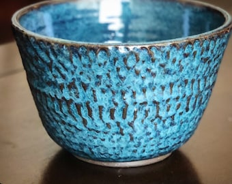 Handmade carved ceramic bowl