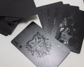 Black Poker playing cards game throwing card