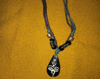 African carved bone and colorful cord 22 inch necklace