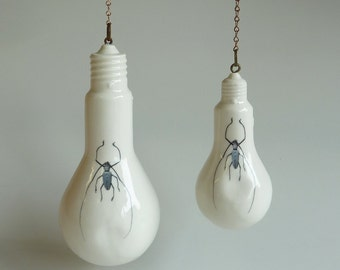 Porcelain light bulb with decorative chain and insects/ moths