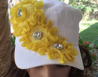 White Flat Top Cap Embellished with Yellow Ribbon Flowers with Gold and Rhinestone Centers