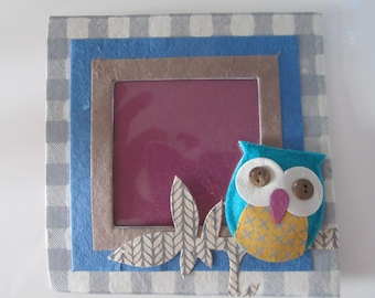 Small cardboard frame with OWL, OWL 3D felt, cardboard, and buttons