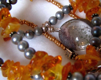 Ice and Gold, amber and freshwater pearls, with a gorgeous quartz teardrop pendant.