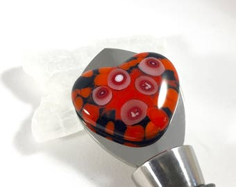 heart bottle stopper in stainless steel, red, black, white, and murrini fused glass