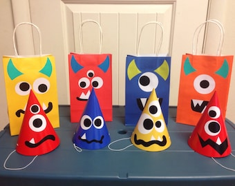 Monster party hats and matching treat bags