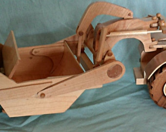 Hand crafted wood scraper . construction equipment
